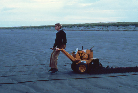 Dick Sternberg cutting a ditch for data and power cables to offshore instruments